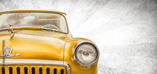 Retro car. Classic USSR GAZ. Photo in vintage style. Beauty round forms. Orange color tones. Background old paper.