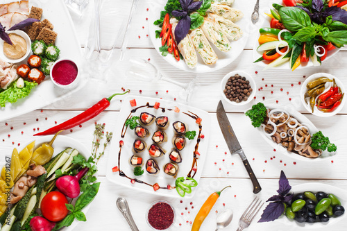Foto auf Gartenposter Bar Traditional russian tableful, food variety, flat lay. A lot of different tasty snacks for vodka with empty glass decanter. Holiday, party, banquet, wedding, restaurant, buffet concept