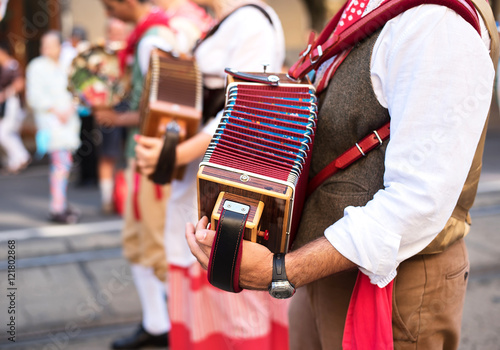 Fotografie, Tablou  Man play accordion in carnival on street