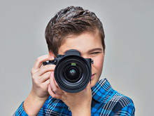 Boy With Photo Camera Taking P...