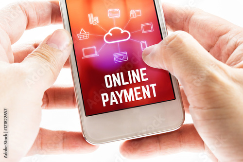 Fotografía  Close up Two hand holding mobile phone with online payment word