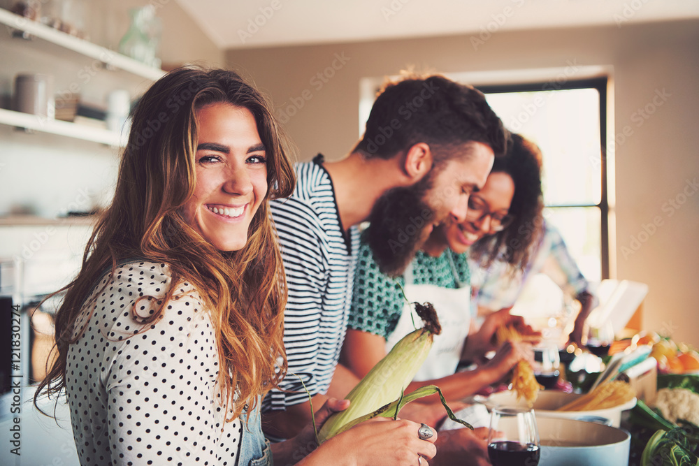 Fototapety, obrazy: Happy woman preparing food at table in kitchen