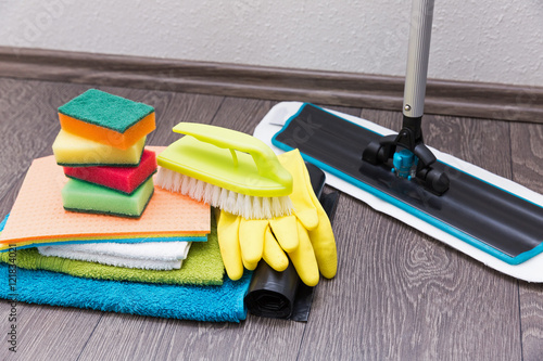 Fotografía  house cleaning equipment and accessories on the laminate floor