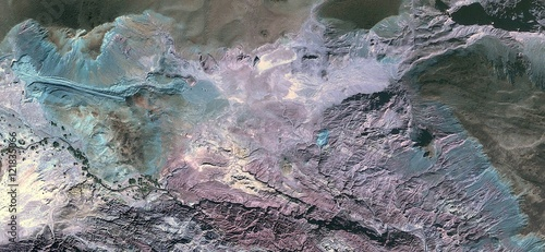 Photo  Pink Flamingo Fossil allegory on  turquoise stone in  African desert,abstract la