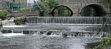 A Weir On The River Tavy In Devon UK