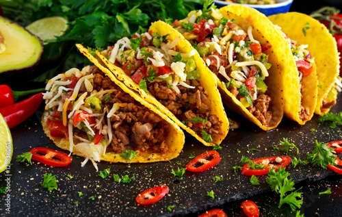 Fotografie, Obraz  Mexican food - delicious taco shells with ground beef and home made salsa