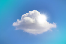 Sunshine Behind A White Puffy Cloud Isolated On A Blue Background