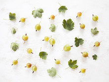 Gooseberry With Leaves On White Wooden Background. Top View.