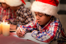 Little Santa Writes A Letter. Christmas Kid Writing Letter. Congratulating Pen-friends On Christmas. Best Wishes For A Friend.