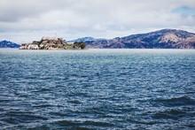 Alcatraz Island By Mountain Against Cloudy Sky