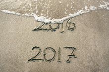 Good Bye 2016 Hello 2017. 2016 Handwritten Text Letters Washed By Wave.