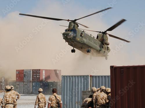 Fotografie, Obraz Helicopter Landing at Desert Base