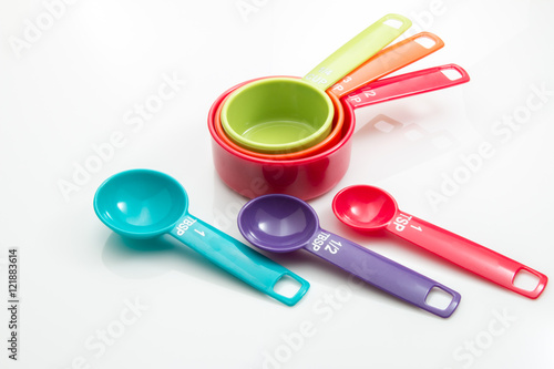 Valokuva  Plastic measuring cups and spoons on a white background.