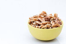Bowl Of Walnuts On A White Background.