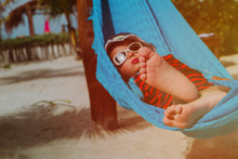 Beach Vacation -happy Little Boy Relaxed In Hammock At Sea