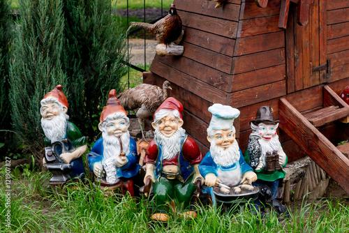 Fotografie, Obraz  Dwarfs decorate the garden near the house
