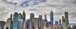 Colorful panoramic picture of downtown Manhattan from Brooklyn; New York on a cloudy sky