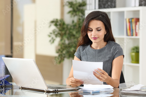 Fotografie, Obraz  Businesswoman reading a letter at office