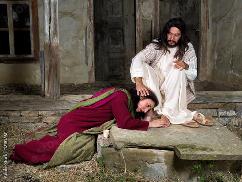 Mary Magdalene crying of shame and anointing Jesus' feet Fototapeta