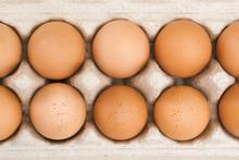 Brown Eggs In Cardboard Package, Top View