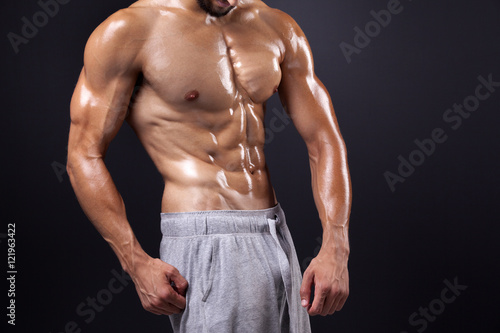 Young bodybuilder showing his abdominal