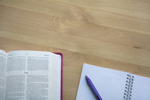 Bible Study And Notebook On The Desk