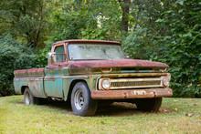 Vintage Pickup Truck In A Grass Field