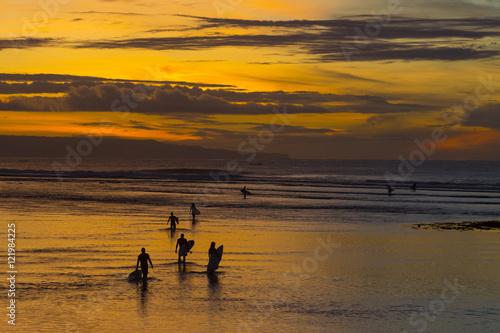 Bali Surfers at sunrise. Bali. Indonesia.