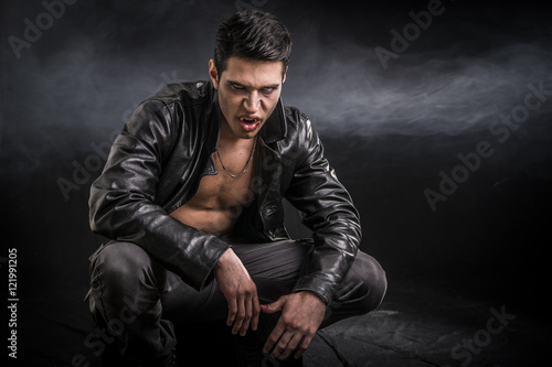 Young Vampire Man in an Open Black Leather Jacket Fotobehang
