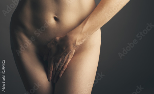 part of a nude woman body with close hands between the legs in Slika na platnu