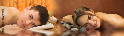 Foto op Plexiglas Spa Beautiful couple of lying woman and man in a spa salon with water reflection