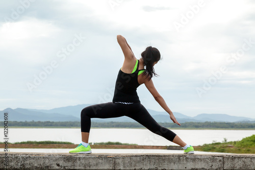 lady exercise and stretching in natural view