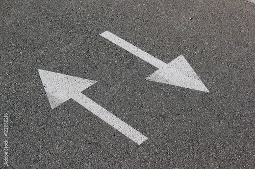 Two arrows on asphalt. Sign of two-way street. Canvas-taulu