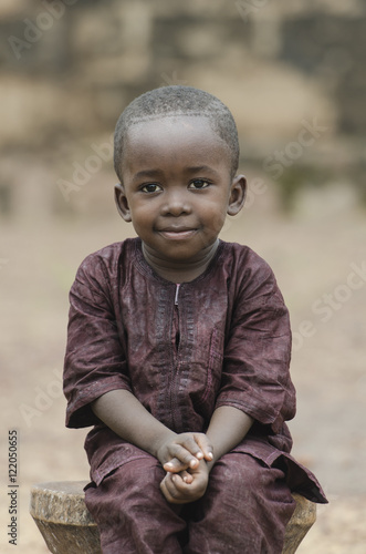 Valokuvatapetti Handsome young African boy smiling happily outdoors (Peace for Africa)