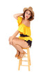 Gorgeous woman sitting on a chair.