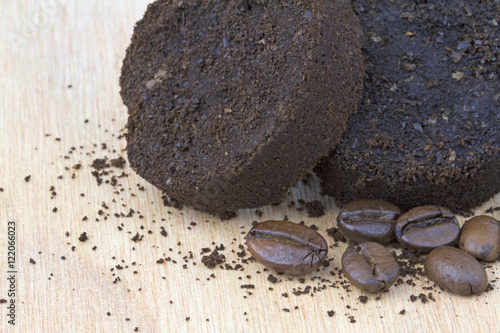 Fotografie, Obraz  Used coffee grounds after espresso machine and coffee beans on wooden background