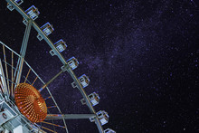 Low Angle View Of Ferris Wheel Against Starry Sky