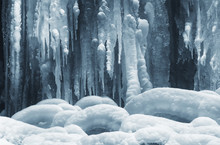Icicles On Frozen Waterfall In Winter