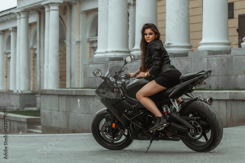 Fotografia, Obraz  Biker girl rides a motorcycle in the rain. First-person view