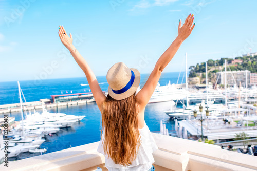 Fotografie, Obraz  Young female traveler enjoying great view on the harbor with yachts in Monte Car
