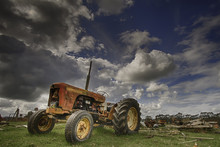Vintage Tractor In Field Aga...