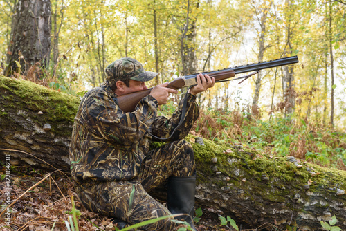 Poster Jacht Hunter with a gun in the autumn woods, hunting for a hazel grouse