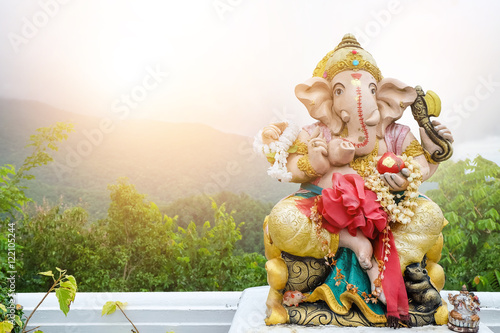 фотография A beautiful statue of Ganesh On the background landscape