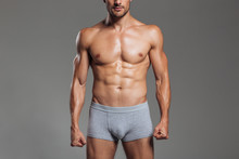 Cropped Image Of A Handsome Muscular Men Body In Underwear