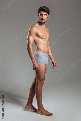Portrait of a serious muscular man in underwear looking away