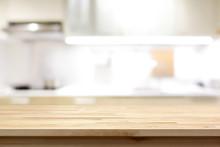 Wood Countertop (or Kitchen Island) On Blur Kitchen Interior Background