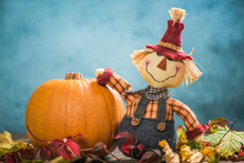 Funny Scarecrow Holding Pumpkin