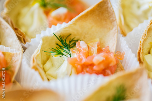 Fotografering  close up of dough cornet with salmon fish filling