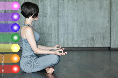 Fotografie, Obraz  Woman practicing meditation with the chakras