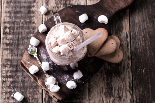 Spoed Foto op Canvas Chocolade Hot chocolate with marshmallows in white cup, rustic wood background, copy space